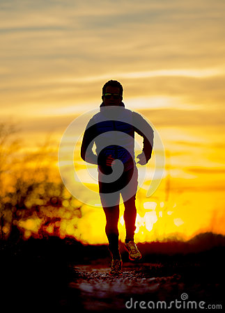Free Silhouette Front View Of Young Sport Man Running Outdoors In Off Road Trail Track With Autumn Sun At Orange Sky Sunset Royalty Free Stock Photo - 62524505