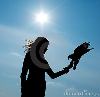 Silhouette of girl and bird