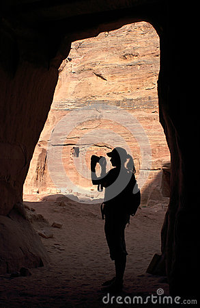 Silhouette of girl in cave