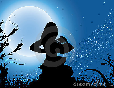 Silhouette of the girl with a fan in a full moon