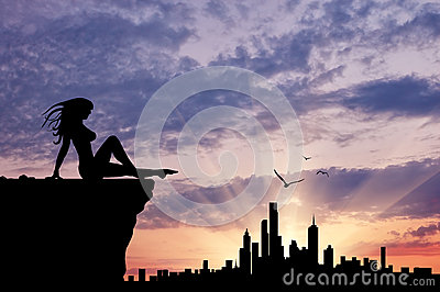 Silhouette of a girl looking at city Stock Photo