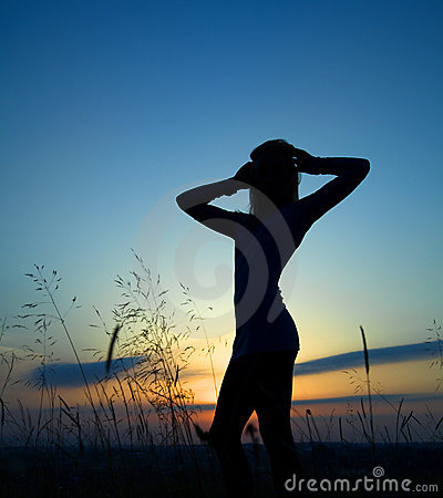 Silhouette of a girl over sunset