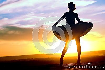 Silhouette of girl in short dress