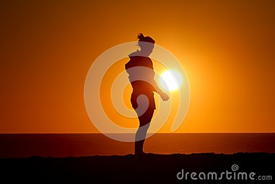Silhouette of girl standing in sunset