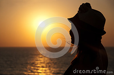 Silhouette of girl on the sunset