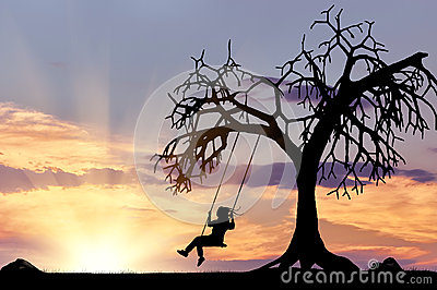 Silhouette of the girl on the swing Stock Photo