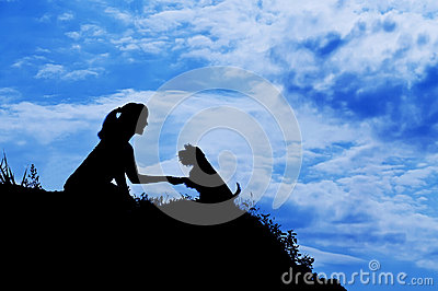 Silhouette of girl train a dog