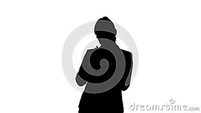 Silhouette Glad ung kvinna som formellt dansar och använder mobiltelefon arkivfilmer