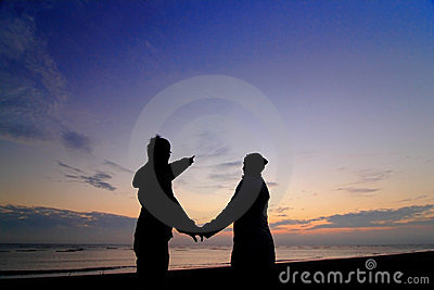 Silhouette of happy couple in love