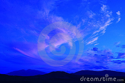 Silhouette of hills with blue sky