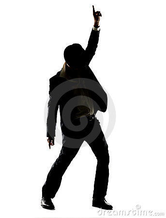 Silhouette image of a young male superstar dancing