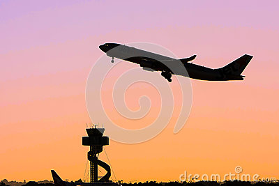 Silhouette of jet airliner in flight