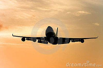 Silhouette of jumbo jet in flight.