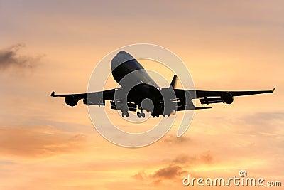 Silhouette of jumbo jet in flight.