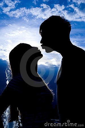 Silhouette of kissing people