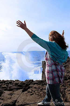 Silhouette of lone woman in her 40s facing wave