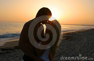 Silhouette Lovers Kissing on tne Beach