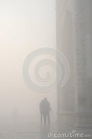 Silhouette of loving couple in a haze ,near Taj Mahal,India