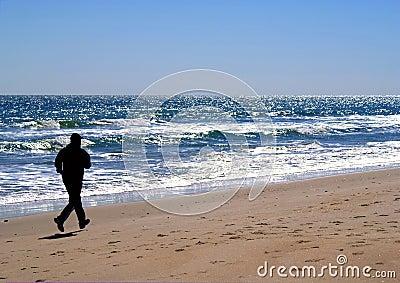 Silhouette of male Jogger in Carolina Beach, NC