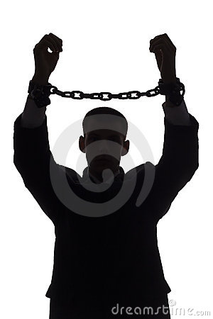 Silhouette of man with chains
