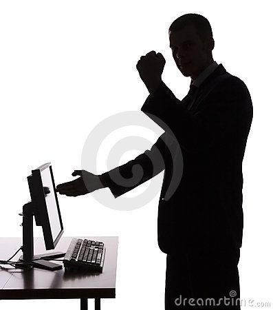Silhouette of man at the computer
