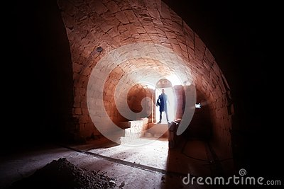 Silhouette of man in crypt