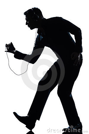 Silhouette man dancing listening to music