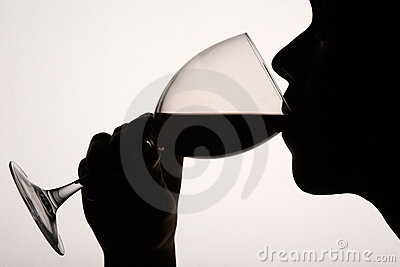 Silhouette of man drinking
