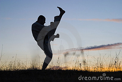 Silhouette of man exercising