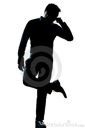 Silhouette man full length looking at his shoes