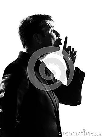 Silhouette  man hushing silence profile