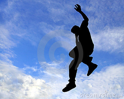Silhouette of man jumping in air