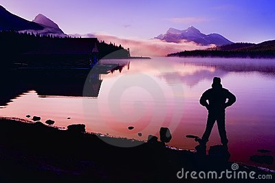 Silhouette Of A Man At A Mountain Lake