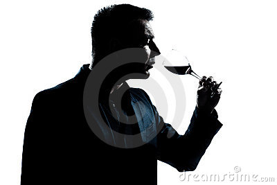 Silhouette man portrait smelling red wine glass
