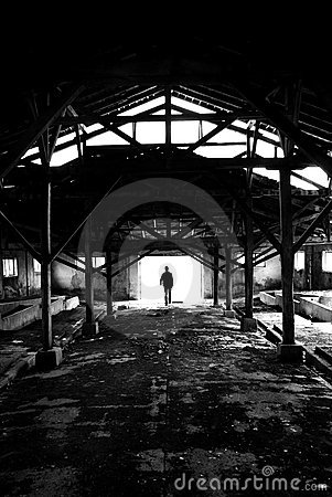 Silhouette man in ruined place