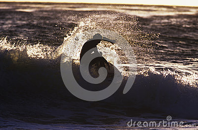 Silhouette Man Surfing Wave