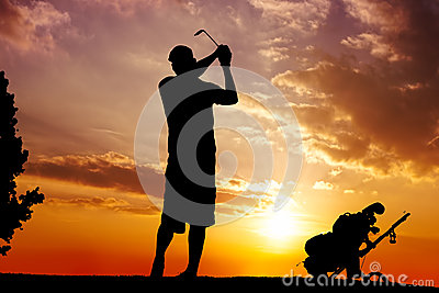 Silhouette of a man swinging