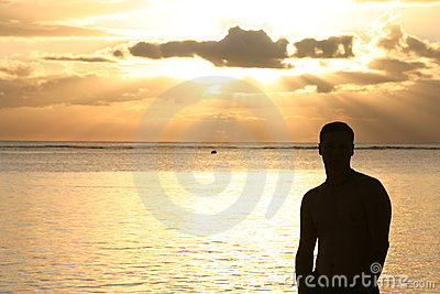 Silhouette of a man watching the sunset