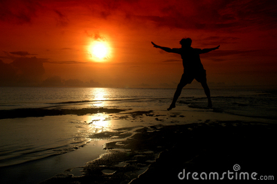 Silhouette of a man who jumped into the sun
