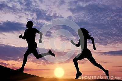 Silhouette men and women runners-up Stock Photo