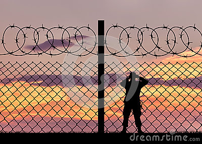 Silhouette of a military border guard Stock Photo