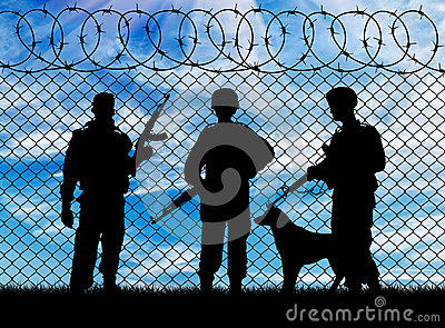 Silhouette of the military and the dog Stock Photo