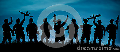 Silhouette of military soldiers team or officer with weapons at Stock Photo