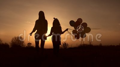 Silhouette mother and daughter at the sky sunset. stock video footage