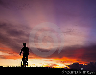 The silhouette of mountain bicycle rider