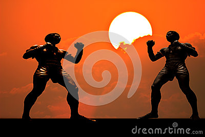 Silhouette muay thai boxer in sunset background