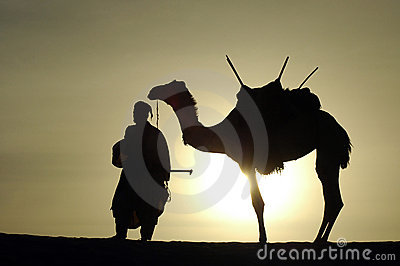 Silhouette of a nomad and camel