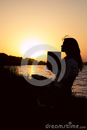 Free Silhouette Of A Beautiful Young Woman Reflect On The Information Read In A Book On Nature Royalty Free Stock Image - 75093896