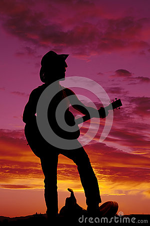 Free Silhouette Of A Cowboy Foot On Saddle Playing Guitar Royalty Free Stock Photography - 63853507