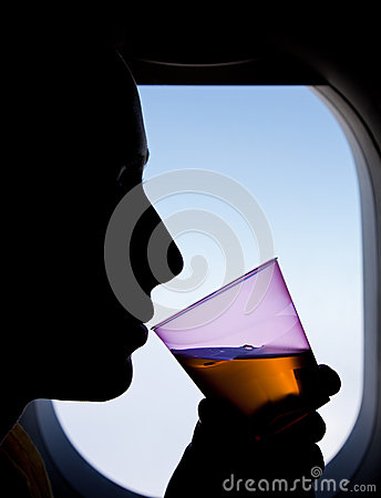 Free Silhouette Of A Woman Passenger Beside Airplane Window Royalty Free Stock Photo - 32221475